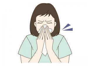 花粉症で鼻をかむ女性のイラスト