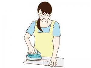 アイロンがけをしている女性のイラスト