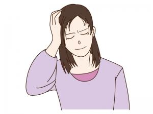 頭痛で頭を押さえている人のイラスト