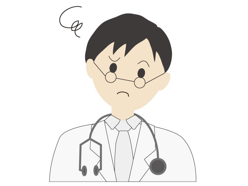 困った表情をしている若い男性の医師イラスト
