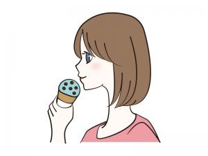 チョコミントアイスを食べる女性のイラスト
