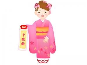 七五三で千歳飴を持っている女の子のイラスト