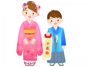 七五三で千歳飴を持っている男の子と女の子のイラスト