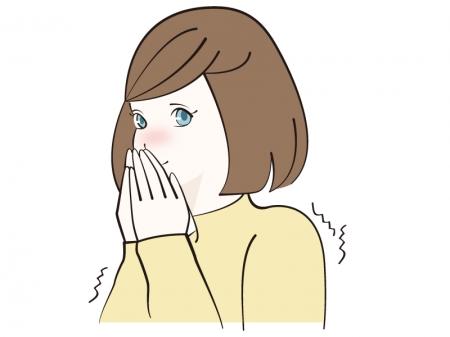 寒くて息で手を温めている女性のイラスト