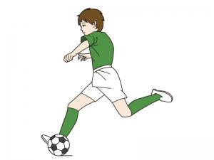サッカーでシュートする少年のイラスト