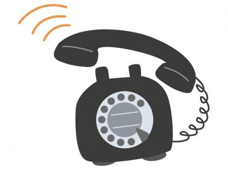呼び出し音が鳴っている黒い電話機のイラスト