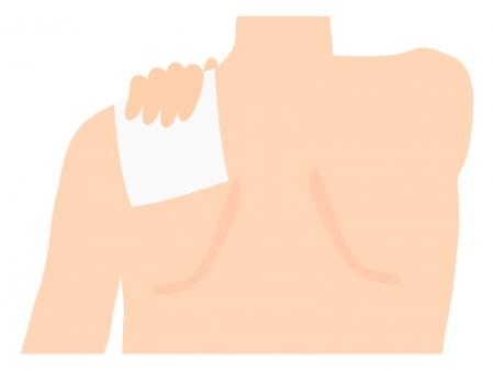 湿布を肩に貼っているイラスト