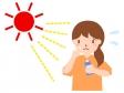 紫外線対策で日焼け止めクリームを塗る女性のイラスト