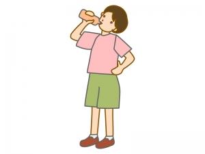 腰に手をあててドリンクを飲む女性のイラスト